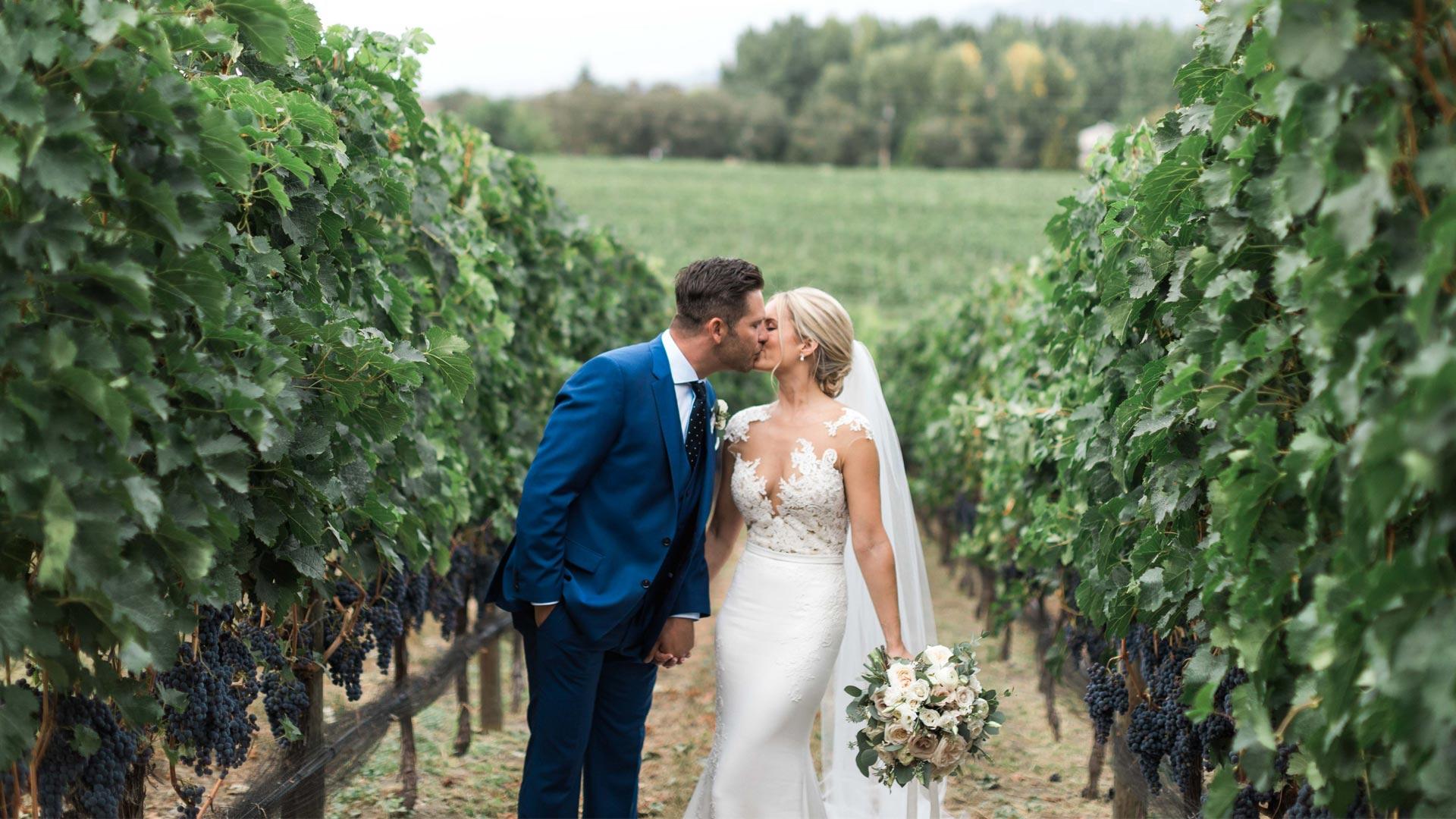 couple posing at Kraze Legs Winery for Okanagan Wedding Videographer Kismet Creative