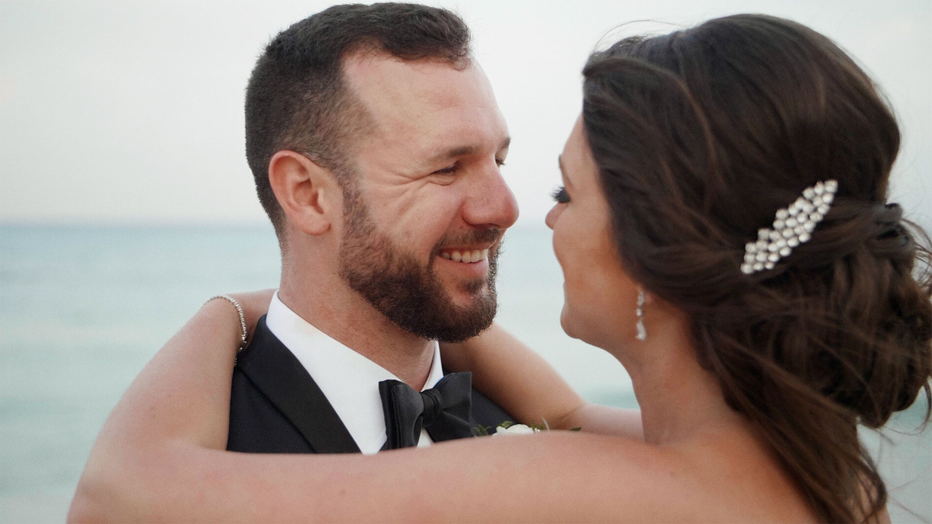 groom smiles at bride during their playa del carmen wedding at Azul fives resort by destination wedding videographer kismet creative