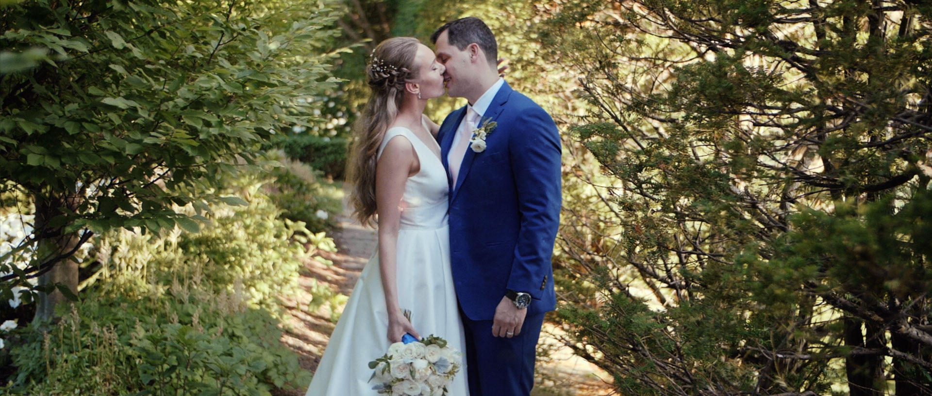 Bride and groom kiss at their Graydon Hall Manor Wedding in Toronto