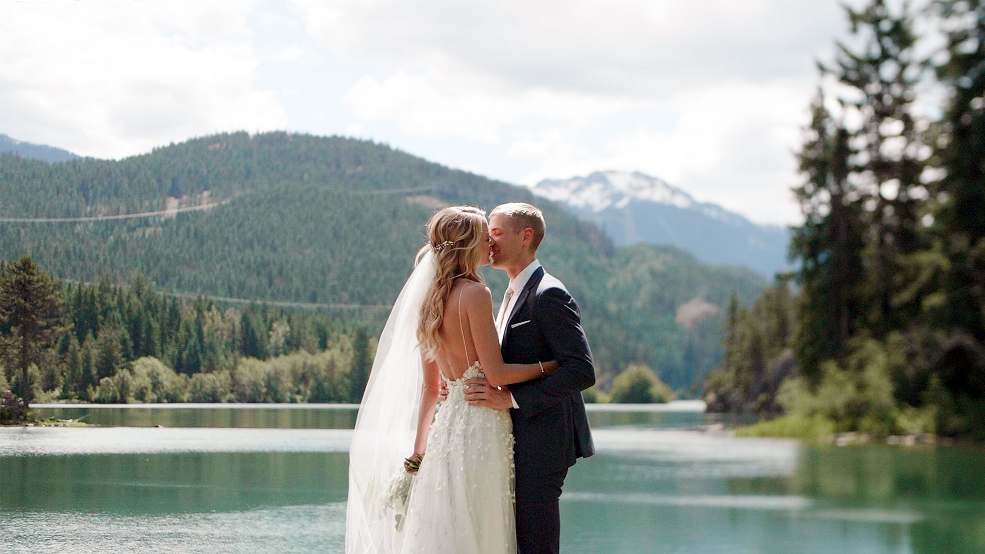 couple pose by lake for their north arm farm wedding by whistler wedding videographer kismet creative