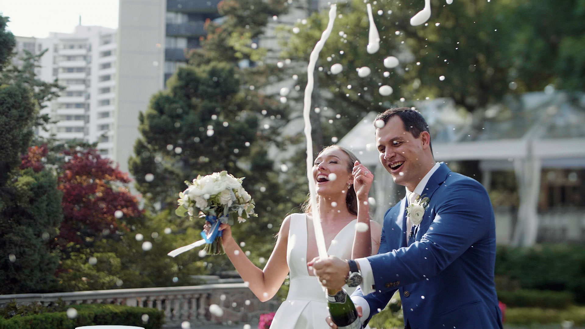 Couple pop champagne at their Graydon hall manor wedding in Toronto