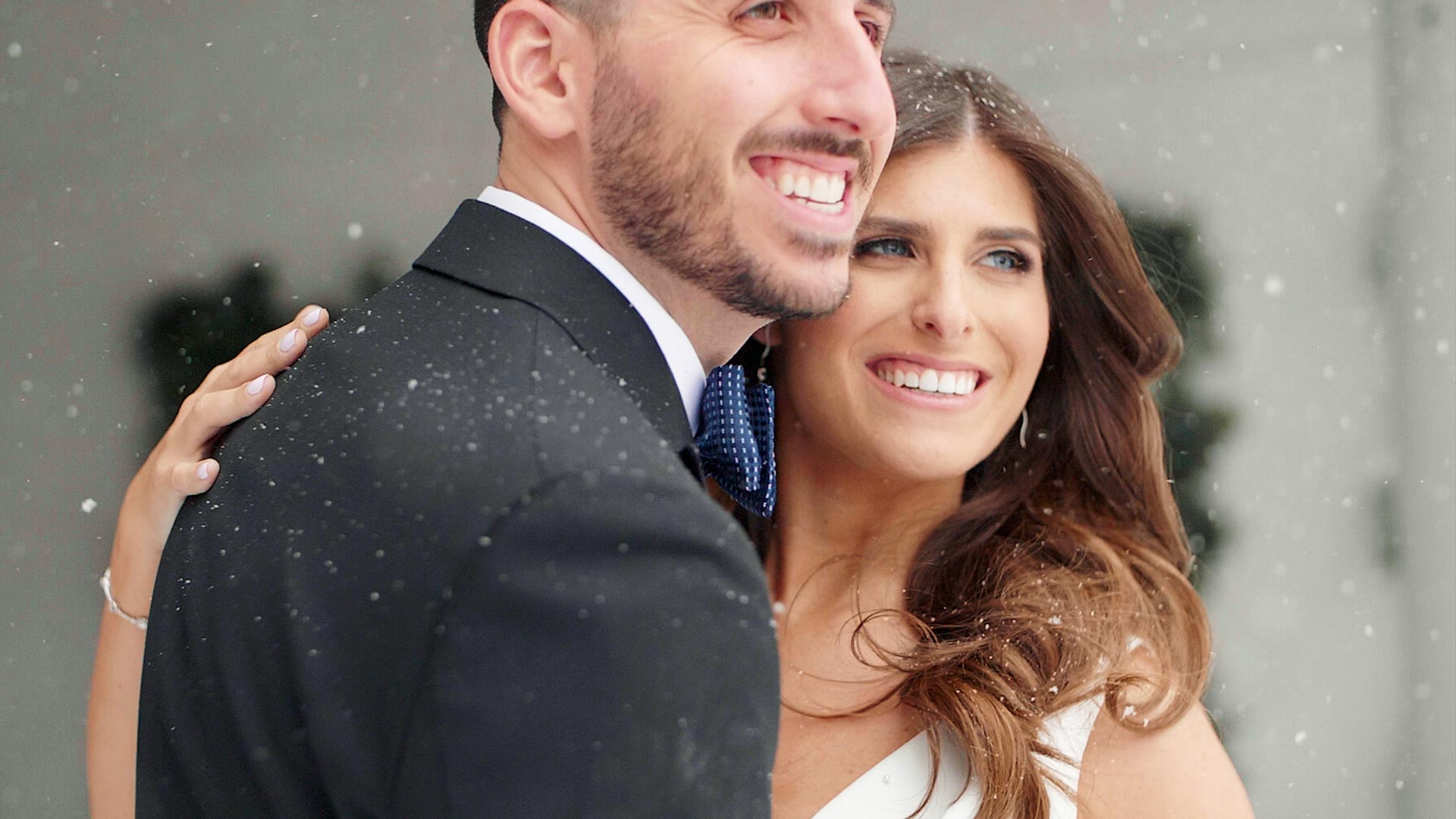 Couple pose for photos in the snow at their hotel x toronto wedding