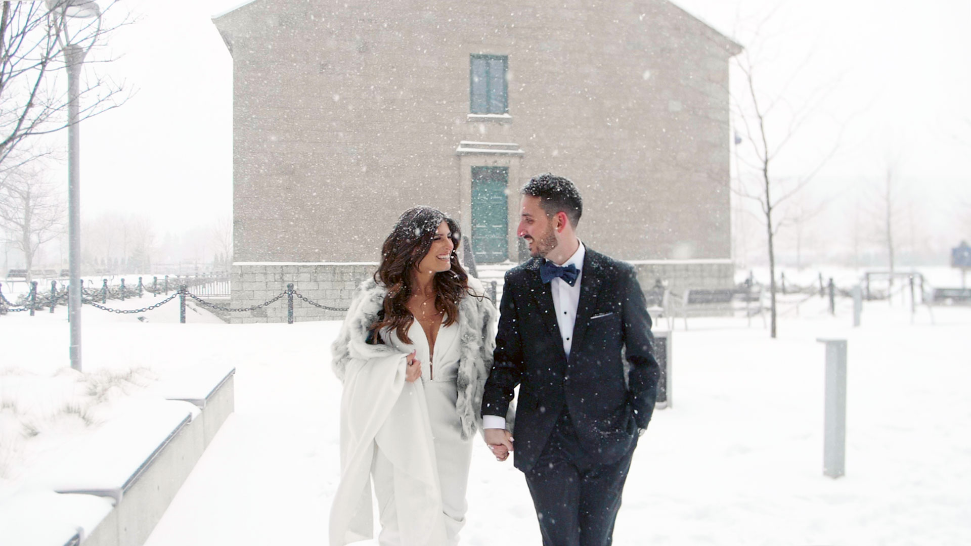 Couple walking in snow at their Hotel X Toronto Wedding by Toronto Wedding Videographer Kismet Creative