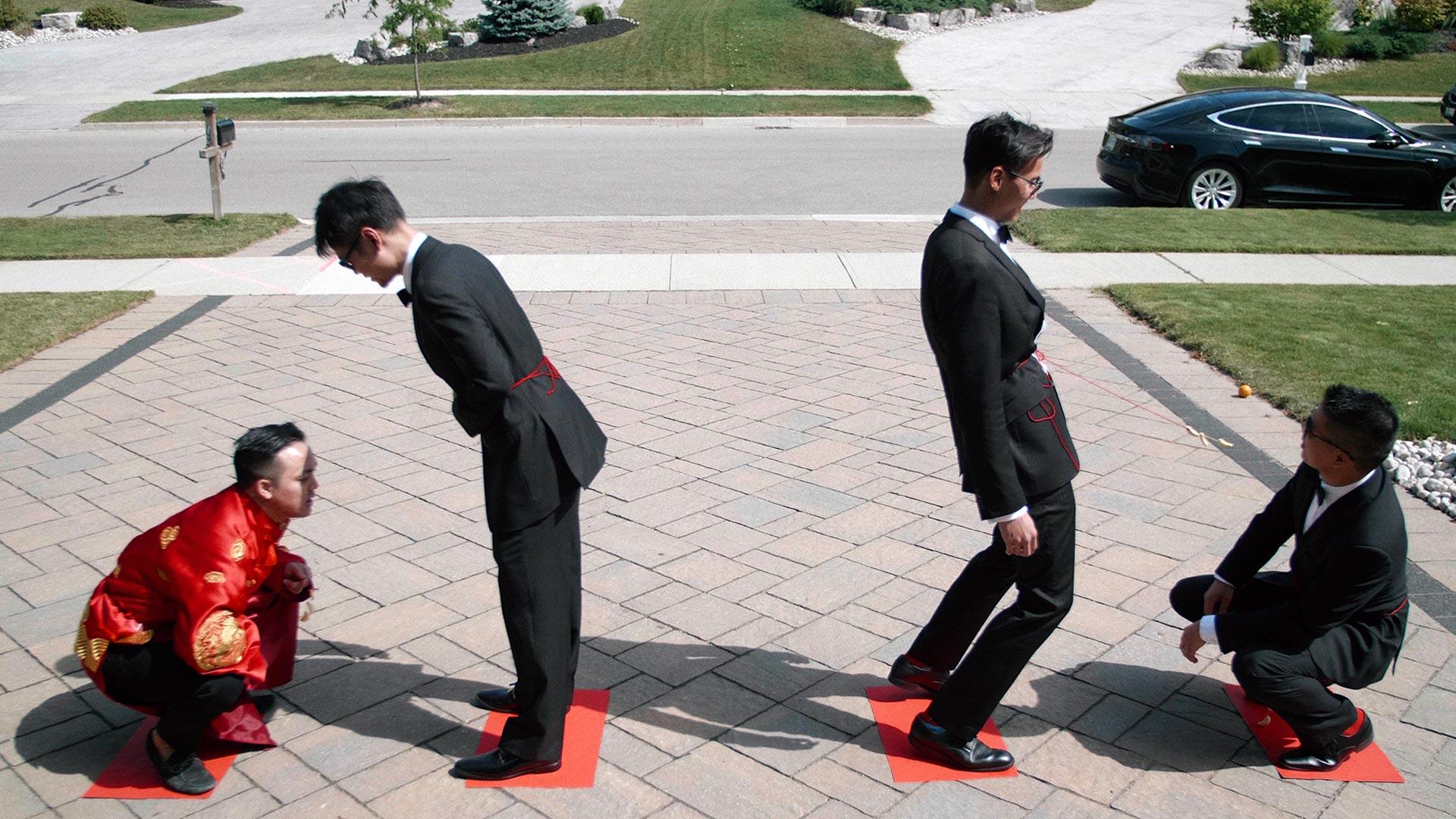 Chinese door games captured by Ontario Wedding Videographer Kismet Creative