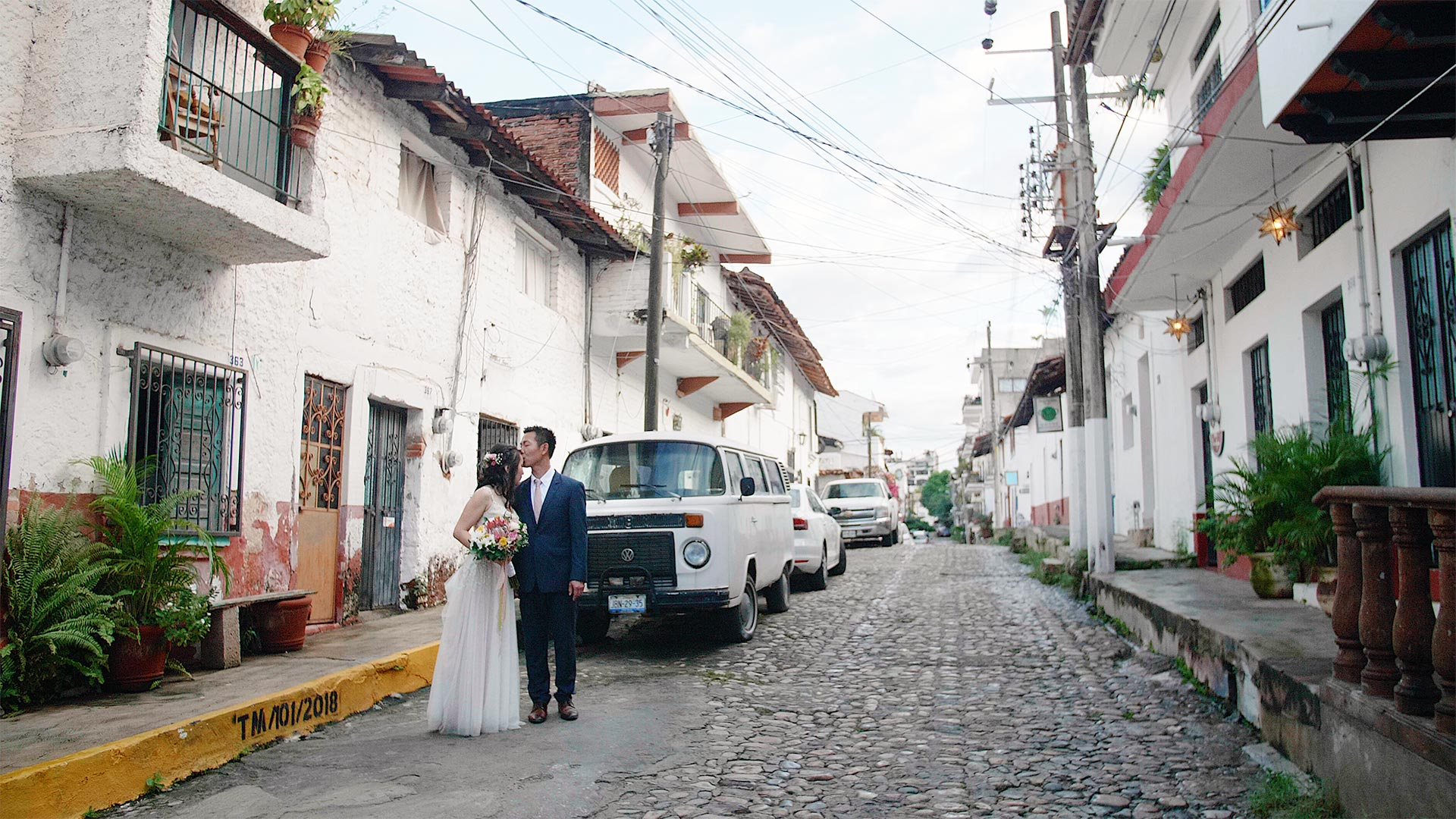 couple walking the streets of Puerto Vallarta by Sayulita Wedding Videographer Kismet Creative