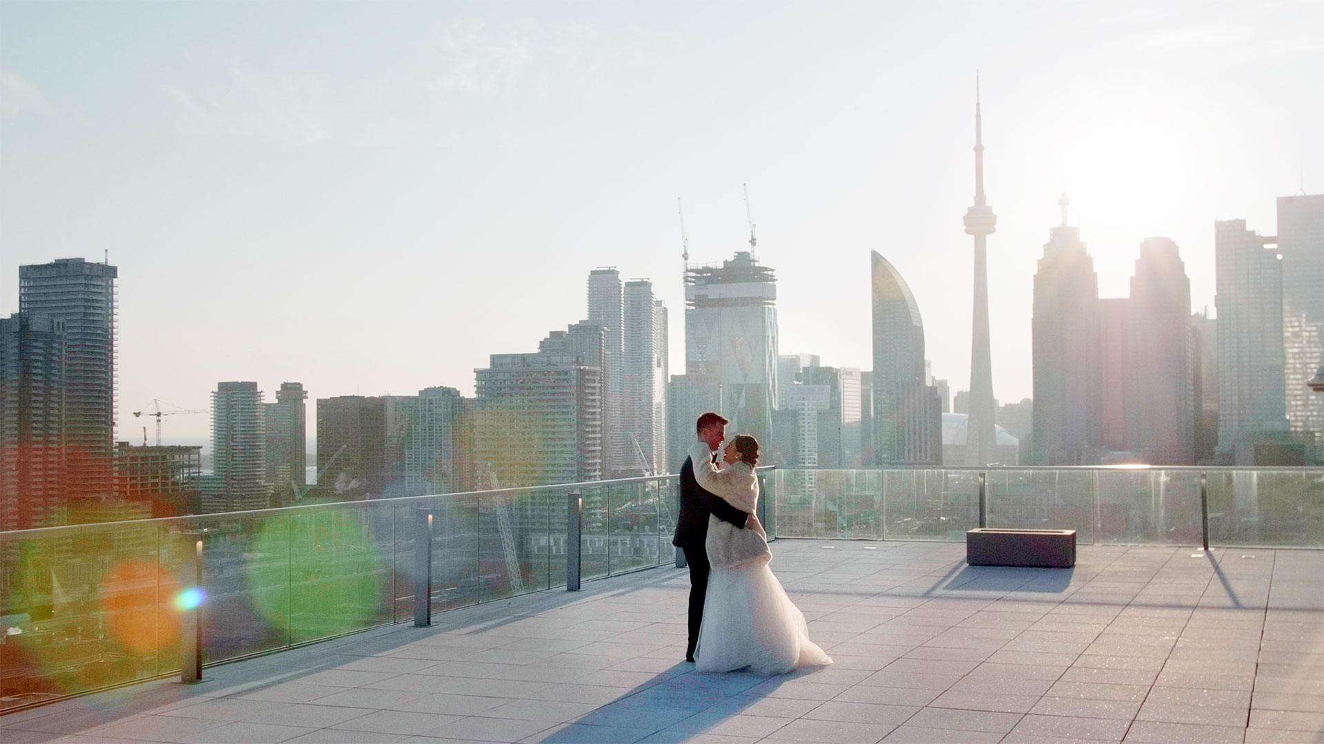 Bride and Groom dance on the rooftop at their globe and mail centre wedding by toronto wedding cinematography kismet creative wedding films