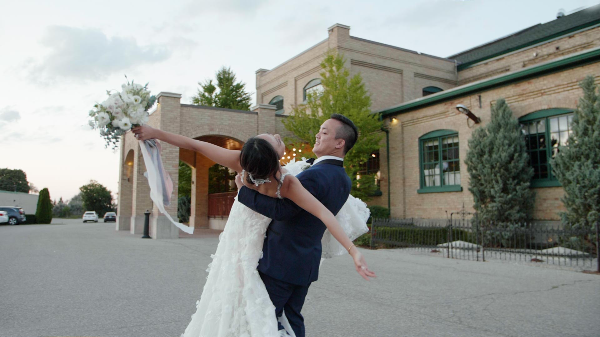 Bride carries groom at their Hacienda Sarria Wedding