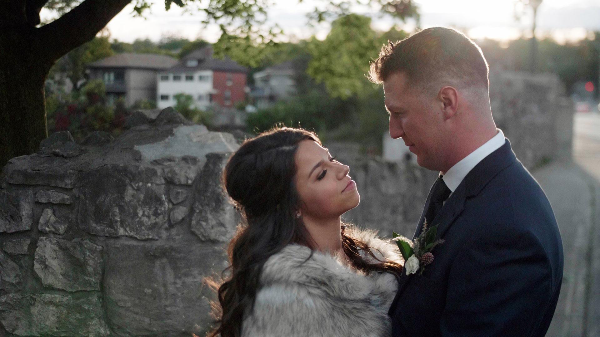 Couple on the bridge in Cambridge during their Cambridge Mill Wedding