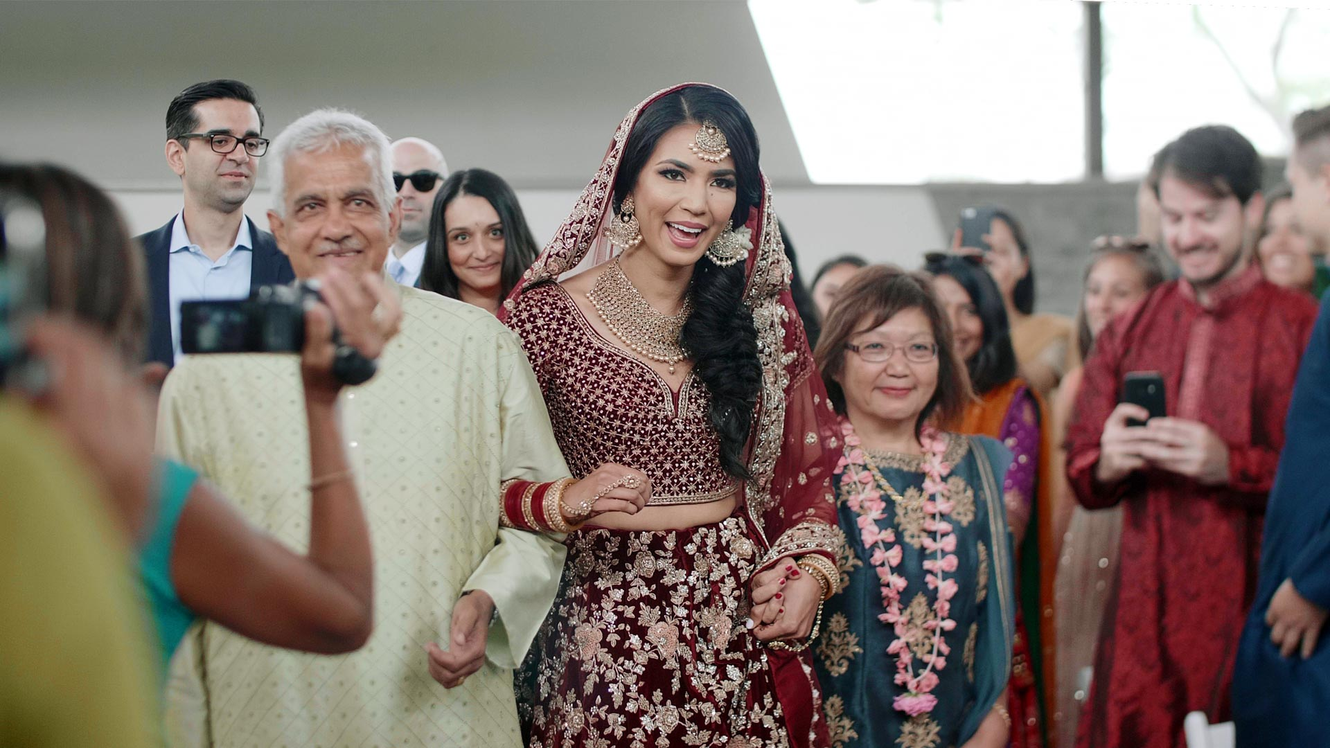 Bride walking down aisle at her hindu ceremony at their guild inn estate wedding toronto