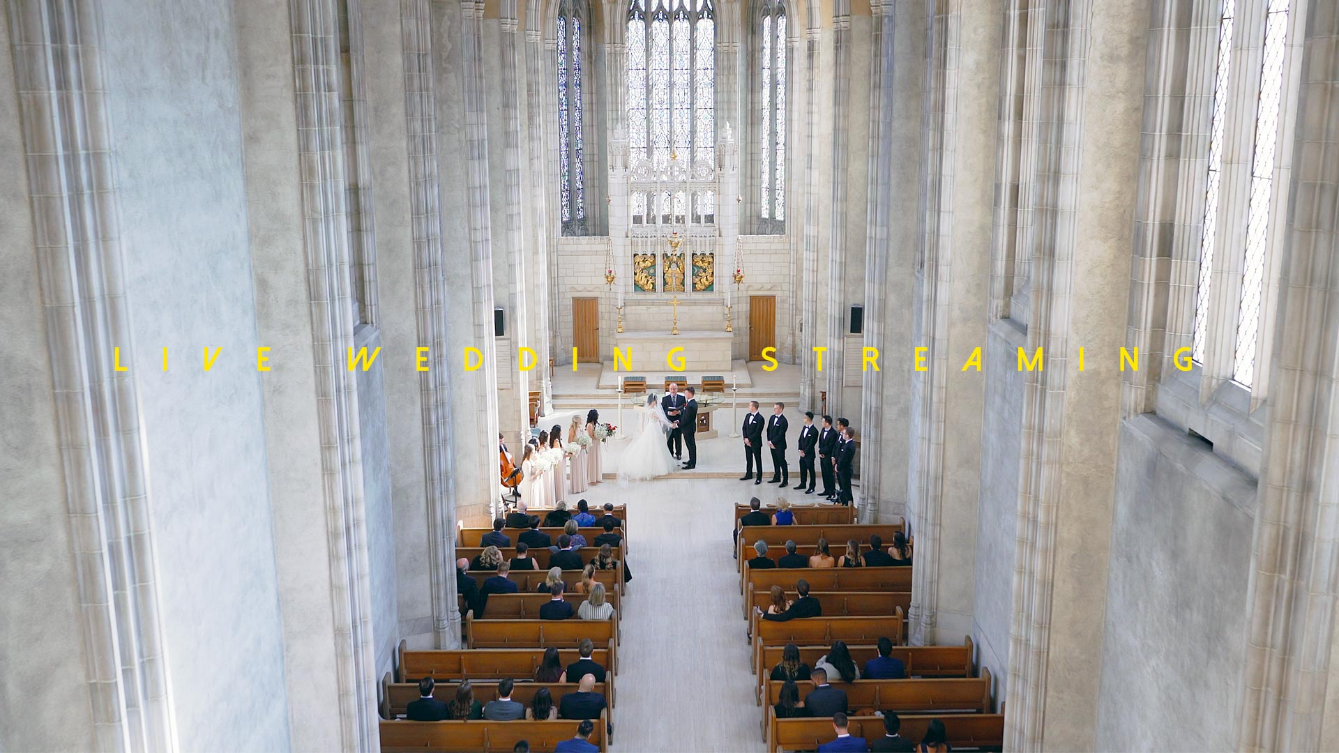 live wedding streaming of a ceremony at Trinity College Toronto