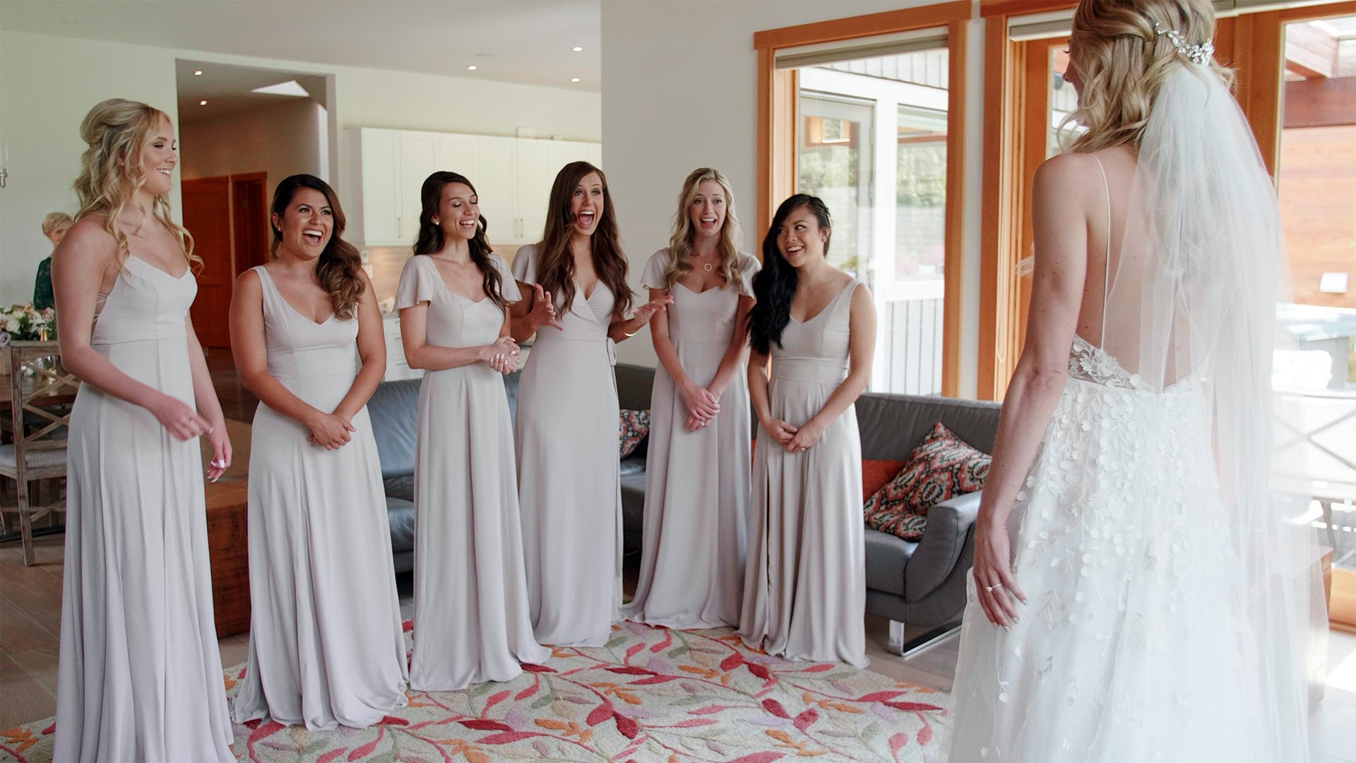 bride reveals her dress to her bridal party at her whistler wedding