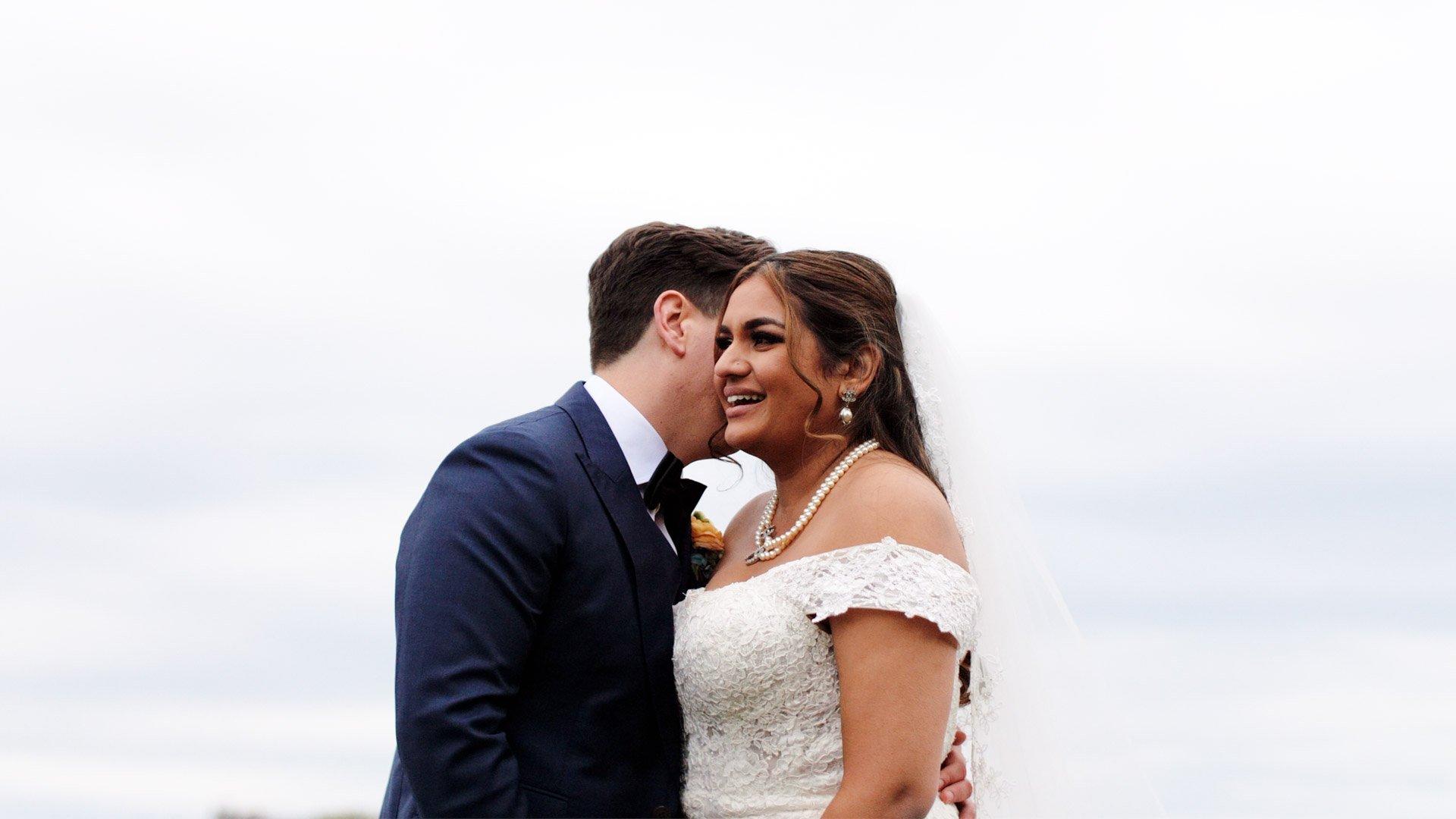 Couple pose during their Royal Ambassador Wedding Film