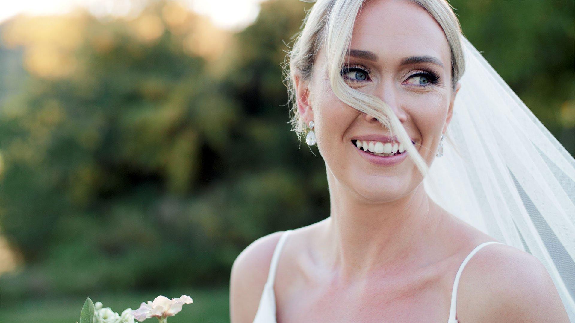 bride smiles at her toronto golf club wedding