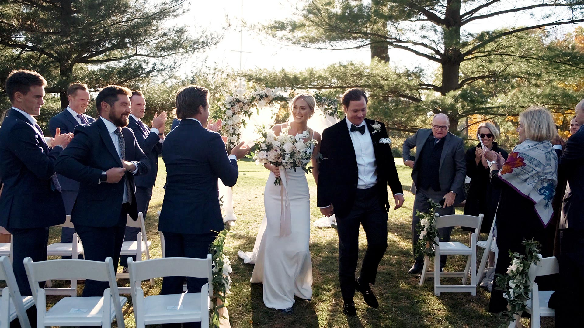 Couple walk down the aisle of their micro wedding ceremony at Toronto Golf Club