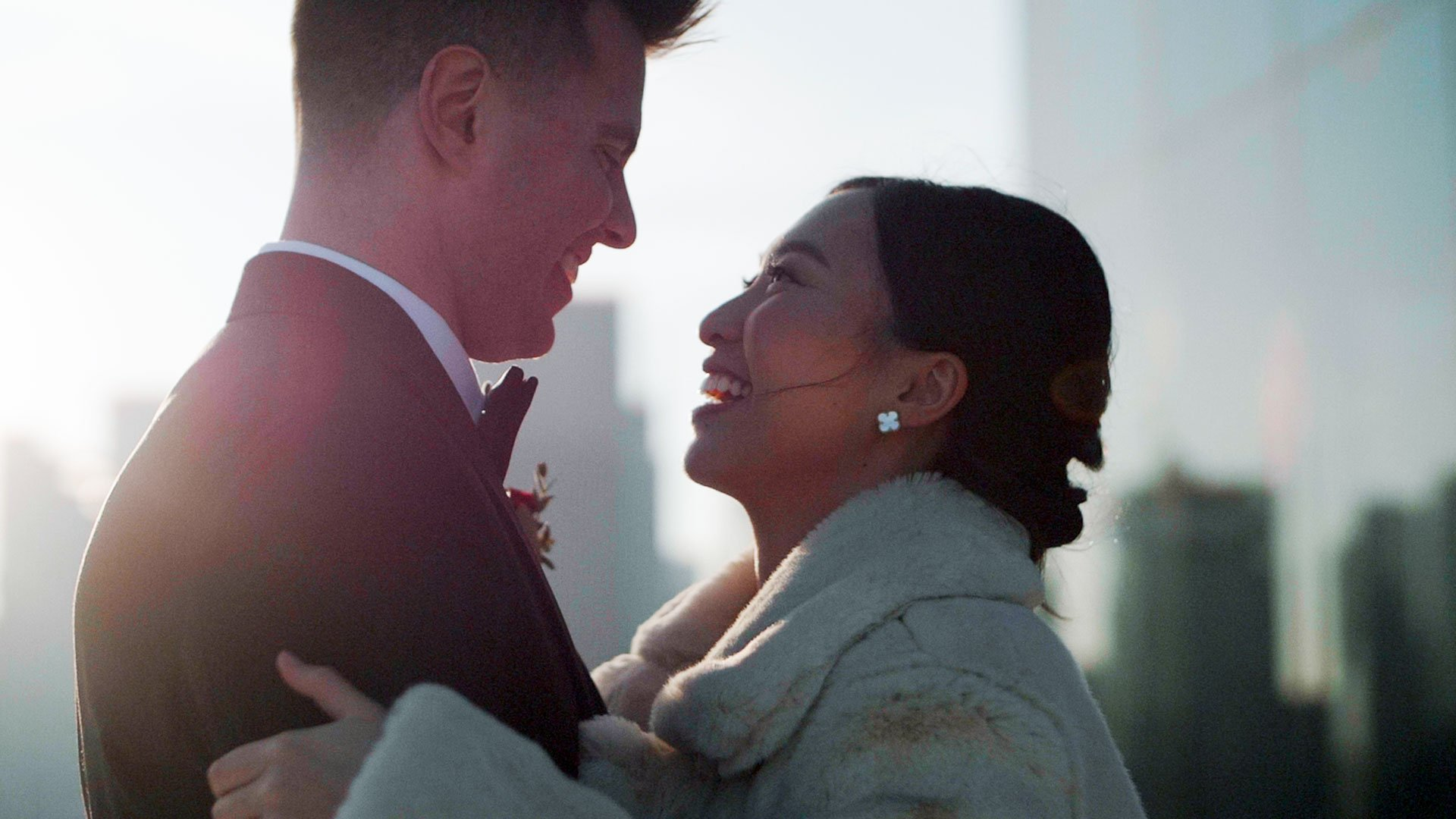 Bride and Groom embrace on the rooftop at their globe and mail centre wedding by toronto wedding cinematography kismet creative wedding films